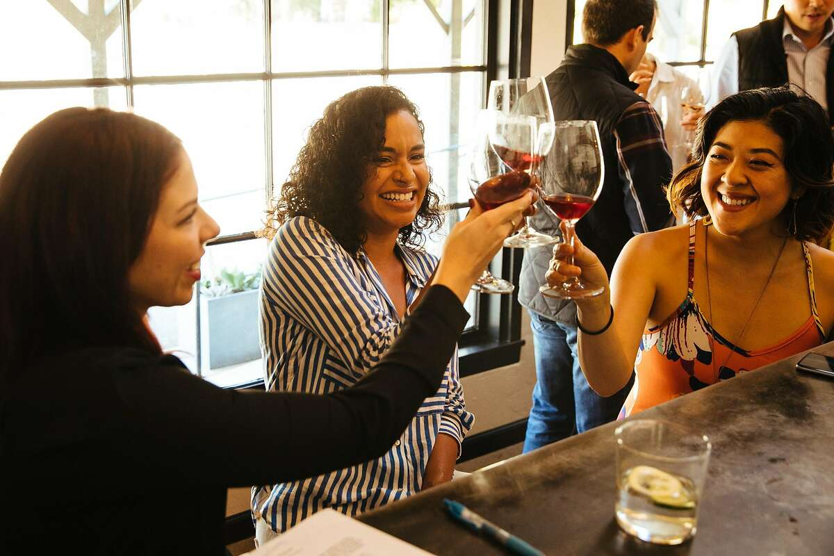 From the left, Kasey Shirk, Brizey Orjuela and Aimy Le cheers during a tasting at the Brand & Family Tasting Room in Carmel, Calif. Thursday, August 24, 2017.