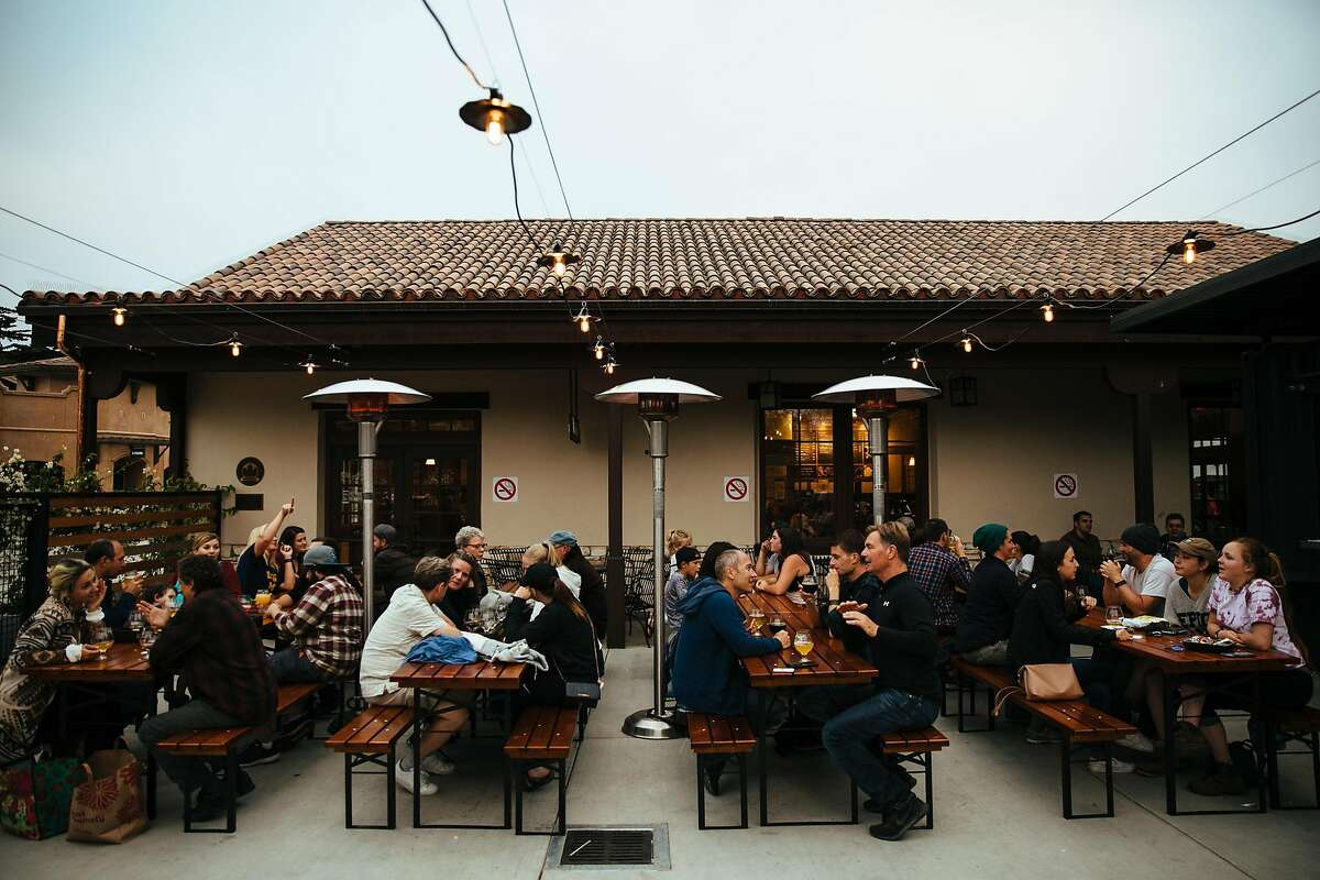 People hang out and enjoy their drinks at the Fieldwork Brewing in Monterey, Calif. Thursday, August 24, 2017.