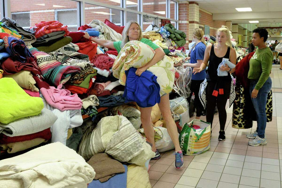 Volunteers sort donated clothing in the Katy ISD shelter for Hurricane Harvey victims at Cinco Ranch High School in Katy, TX on August 28, 2017.