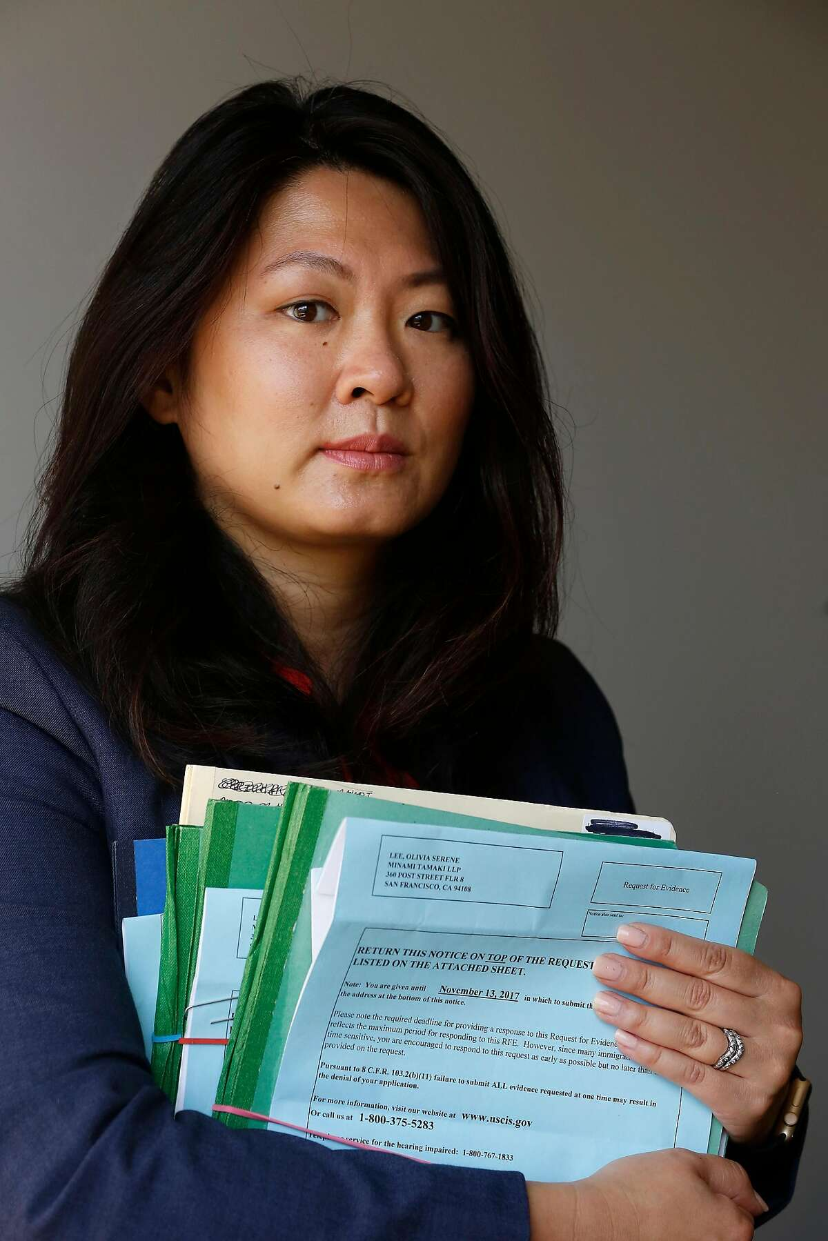 Olivia Lee, senior associate Minami Tamaki LLP, holds