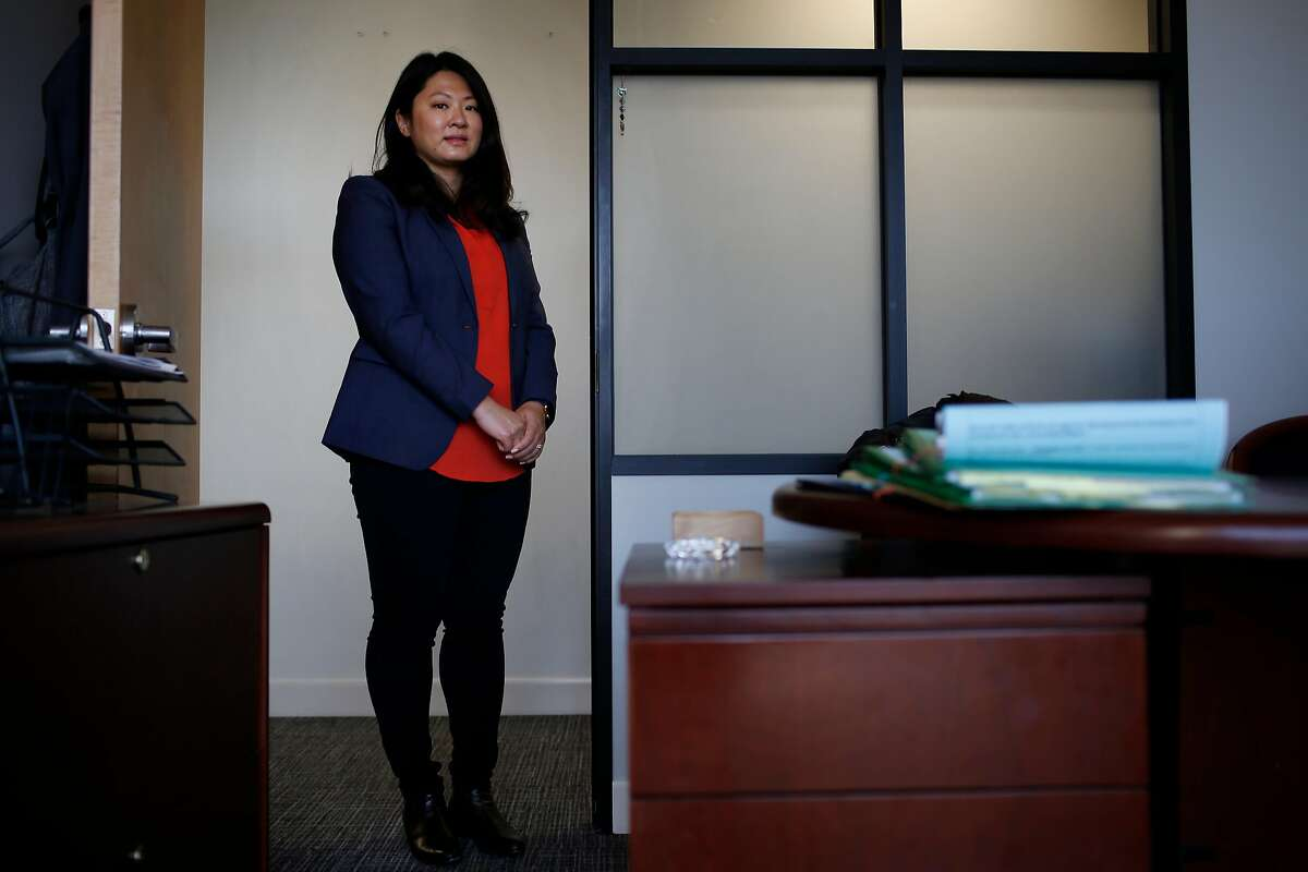 Olivia Lee, senior associate Minami Tamaki LLP, stands for a portrait at her office on Monday, August 28, 2017 in San Francisco, Calif.