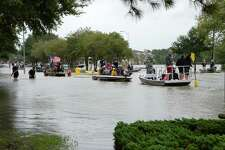 Residents of the Cinco Ranch and Kelliwood areas of Ft. Bend and Harris Counties evacuate from the west side of the Barker Reservoir along Westheimer Parkway in Katy, TX on Tuesday.
