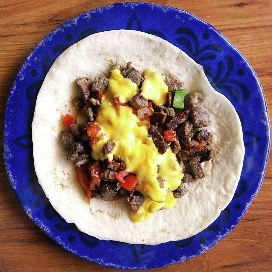 Carne asada a la mexicana taco with queso on a handmade flour tortilla from Lazarita's Mexican Restaurant. Photo: Mike Sutter /San Antonio Express-News