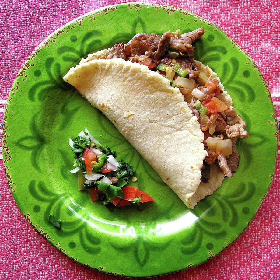 Taco of the Week: Carne asada a la mexicana taco on a handmade corn tortilla from Bertha's Mexican Restaurant. Photo: Mike Sutter /San Antonio Express-News