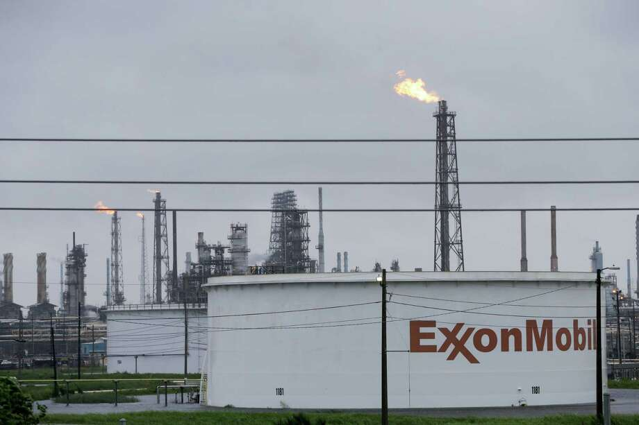 Flares are shown at the ExxonMobil refining complex in Baytown Tuesday, August 29, 2017. Several plants shut down due to Hurricane Harvey. Photo: Melissa Phillip / Houston Chronicle 2017