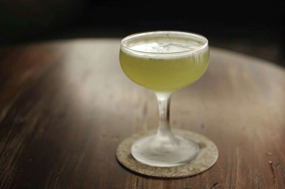 Do good Thursday by sipping a South Side cocktail at one of more than 50 area bars selling the drink to raise funds for Hurricane Harvey relief. Photo: Billy Calzada /San Antonio Express-News / San Antonio Express-News