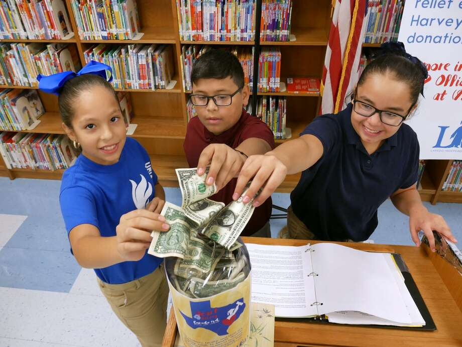 Laredo ISD Superintendent Dr. Sylvia Rios, other administrators and members of the district's Communications Department visited Heights Elementary Tuesday, August 29, 2017, to launch a district-wide monetary drive that will be presented to the American Red Cross for the victims of Hurricane Harvey. Heights Elementary Principal Adriana Padilla and a group of fifth grade students made the initial contribution. Photo: Cuate Santos/Laredo Morning Times