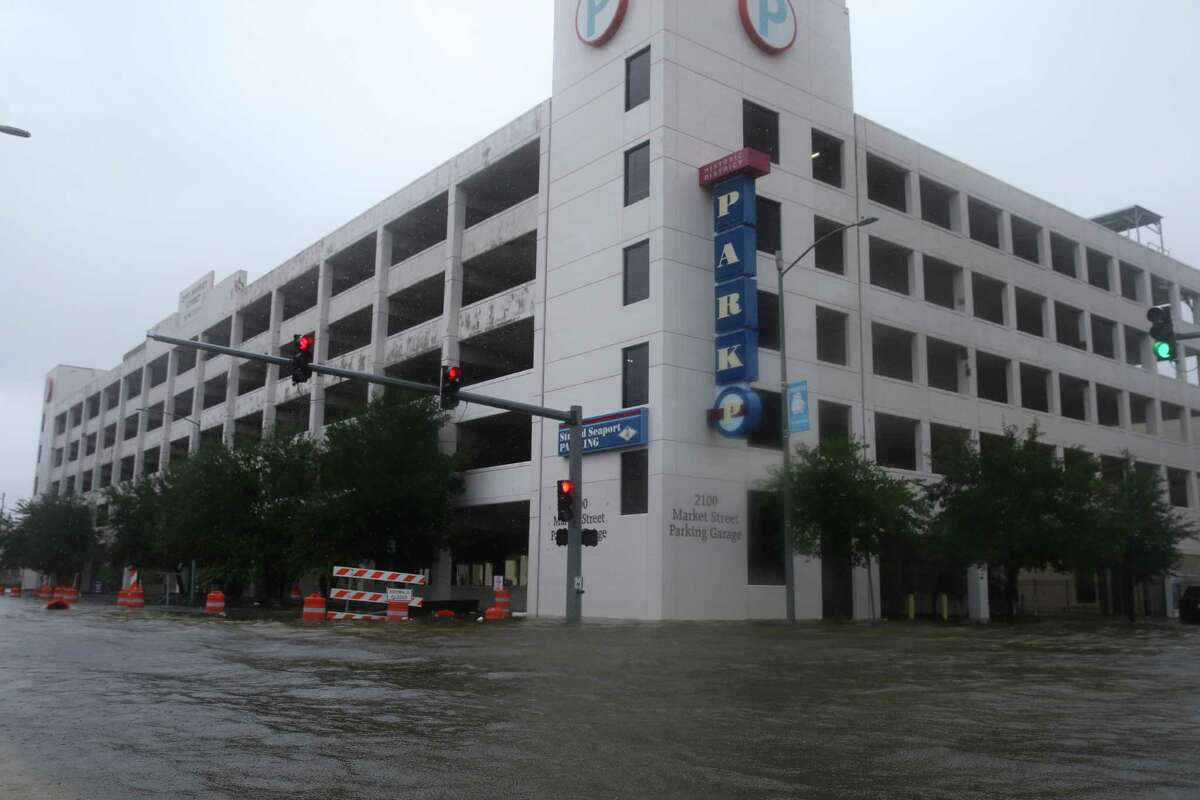 Flood water is about knee-deep in downtown Galveston at the intersection of Moody Avenue and Market Street after on Tuesday, August 29, 2017, in Galveston. Some parts of the downtown section had flood water more than waist-deep.