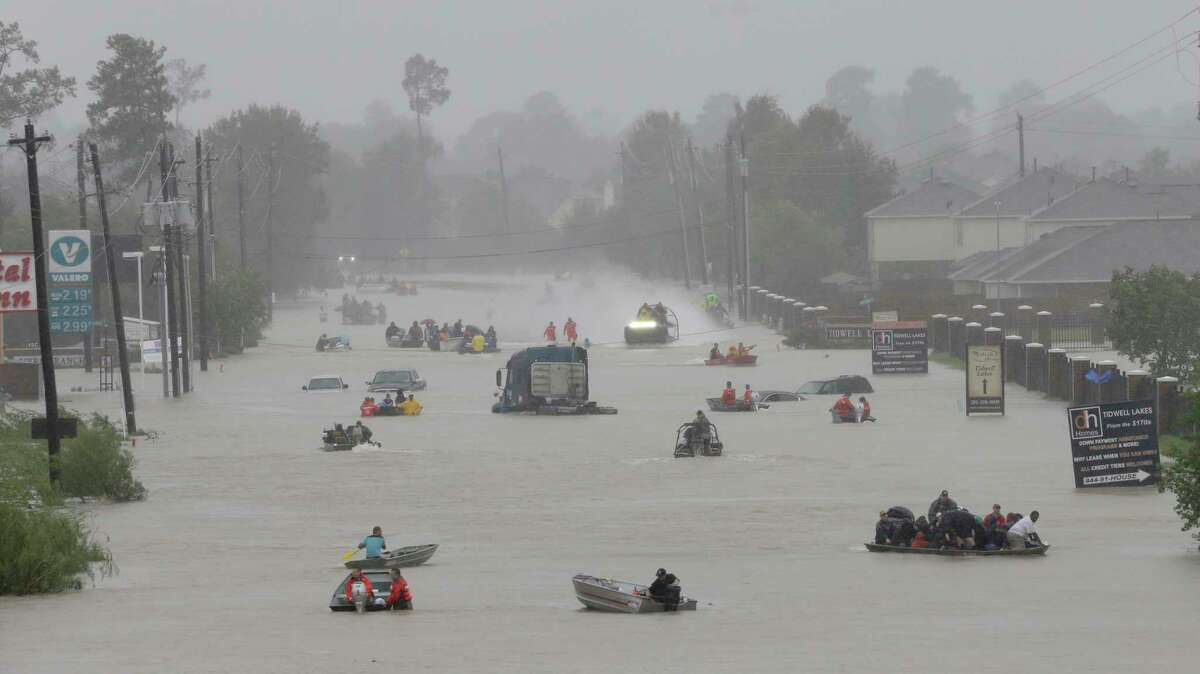 People and rescue boats line Tidwell at the east Sam Houston Tollway, Monday, Aug. 28.