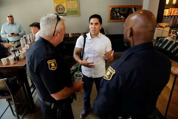 "Matt Noriega-Saito, talks with Berkeley police officers Chris Scott, (left) and Jumaane Jones during a ""Coffee with a Cop"" event at Starbucks in Berkeley, Ca. on Tues. August 29, 2017. No agenda or speeches, just a chance for the public to ask questions, share concerns, and meet some of the Berkeley police officers who work to keep the neighborhoods safe."