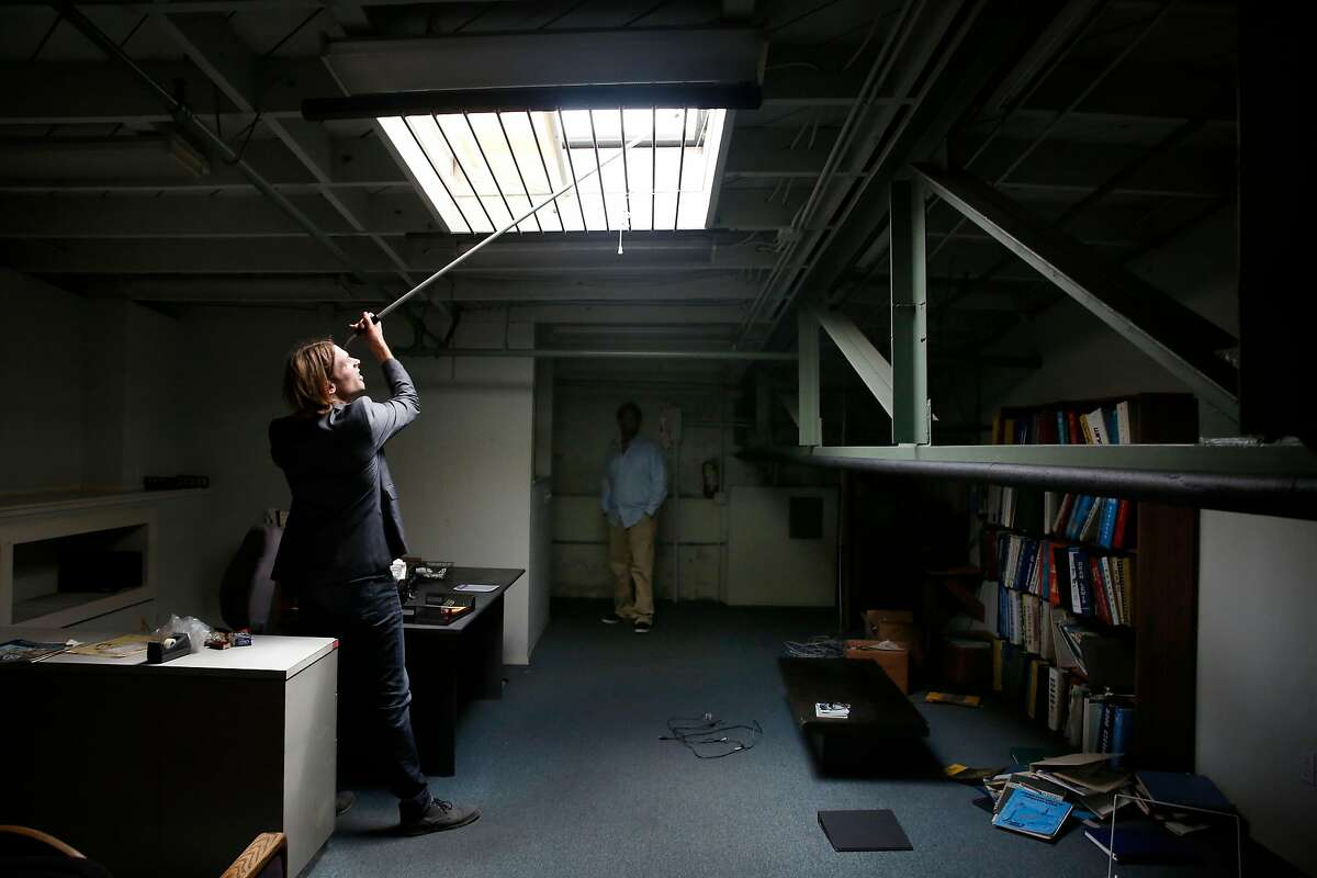 David Brown (l to r), president MESH Design Build Studio, checks out a skylight as Chip Moore, CEO 4&20 Blackbirds, , looks on in a warehouse purchased by Moore and his business partners on Tuesday, August 29, 2017 in Oakland, Calif. MESH Design Build Studio, the design firm hired to renovate a warehouse purchased by Chip Moore and his business partners.