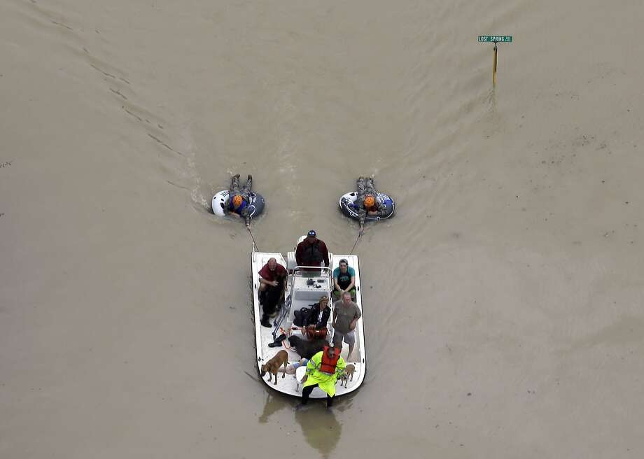 Residents evacuate their homes near the Addicks Reservoir as floodwaters from Tropical Storm Harvey rise Tuesday, Aug. 29, 2017, in Houston. (AP Photo/David J. Phillip) Photo: David J. Phillip, Associated Press