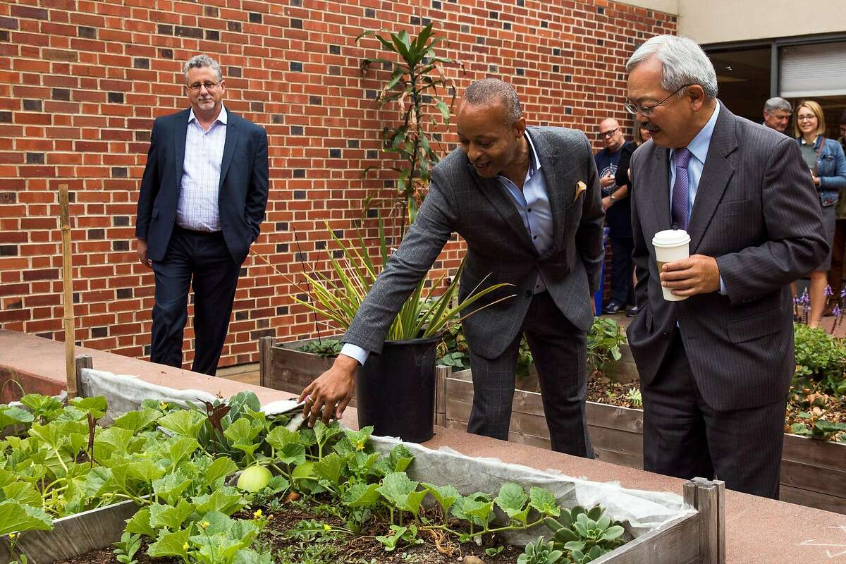 Chief Executive Officer at Positive Resource Center, Brett Andrews, points out to Mayor Ed Lee the raised garden beds outside the Hummingbird Navigation Center at the San Francisco General Hospital in San Francisco, Calif. Tuesday, August 29, 2017.