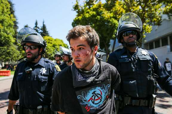 A man is arrested at Martin Luther King Jr. Civic center park during a protest in Berkeley, Calif., on Sunday, August 27th, 2017.