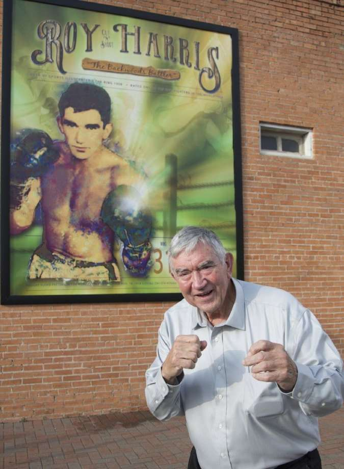 Cut and Shoot retired boxer Roy Harris in front of a mural that was unveiled in October 2014. The Greater Conroe Arts Alliance honored Harris with his contributions to the sport of boxing and to the community. Harris continues to live in the Cut and Shoot area.
