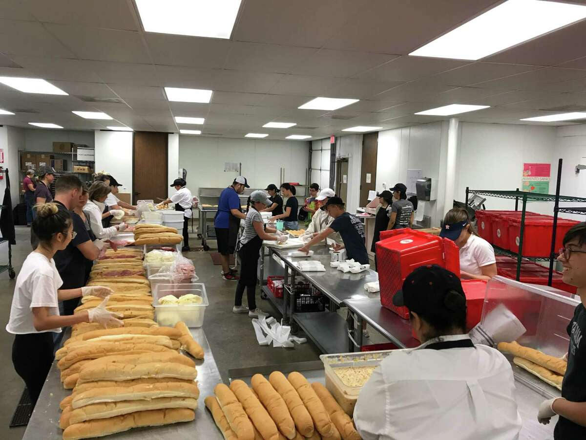 Volunteers at Antone's Po'Boys make sandwiches Tuesday to deliver to shelters, first responders and people at Texas Children's Hospital.