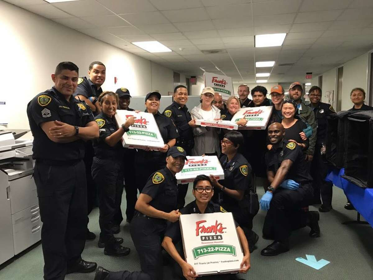Houston Police Department received pizza donated by Frank's Pizza during Hurricane Harvey