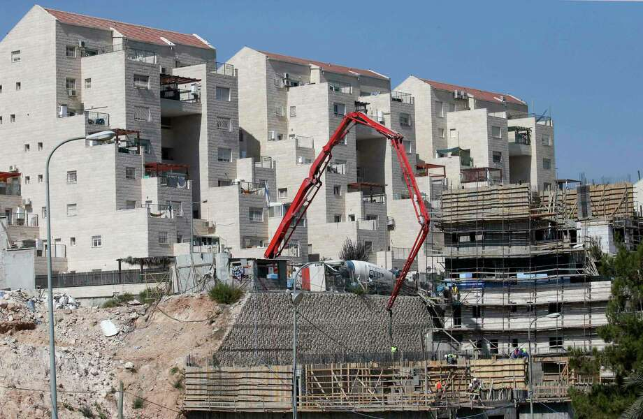 Construction continues in the Israeli settlement of Kiryat Arba. Peace plans have called for some evacuations, to make way for an independent Palestinian state. Photo: HAZEM BADER, Contributor / AFP or licensors