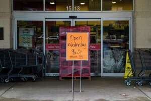 Sign on front of an a HEB located on 1511 W 18th Street announces the supermarket will be open Wednesday from 9:00 a.m to 3:00 p.m stands on front of the door, Tuesday, Aug. 29, 2017, in Houston. ( Marie D. De Jesus / Houston Chronicle )