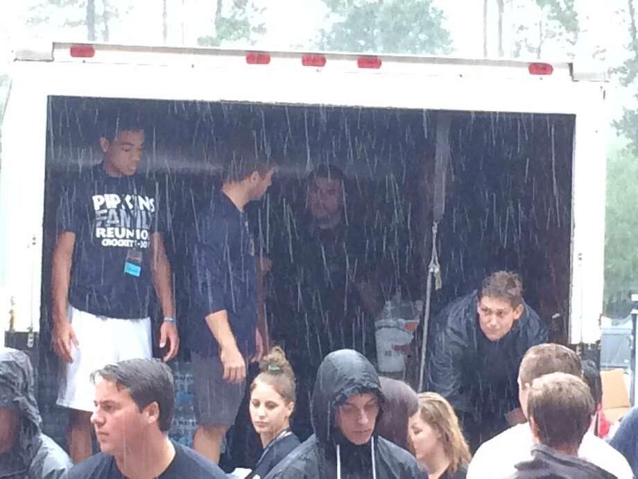 College Park football players help to unload supplies from a U-Haul truck carrying food and water. College Park High School served as a temporary shelter on Monday, August 28, 2017, for evacuees following catastrophic flooding throughout the city of Houston after Hurricane Harvey's historic rain fall. Photo: Twitter Photo