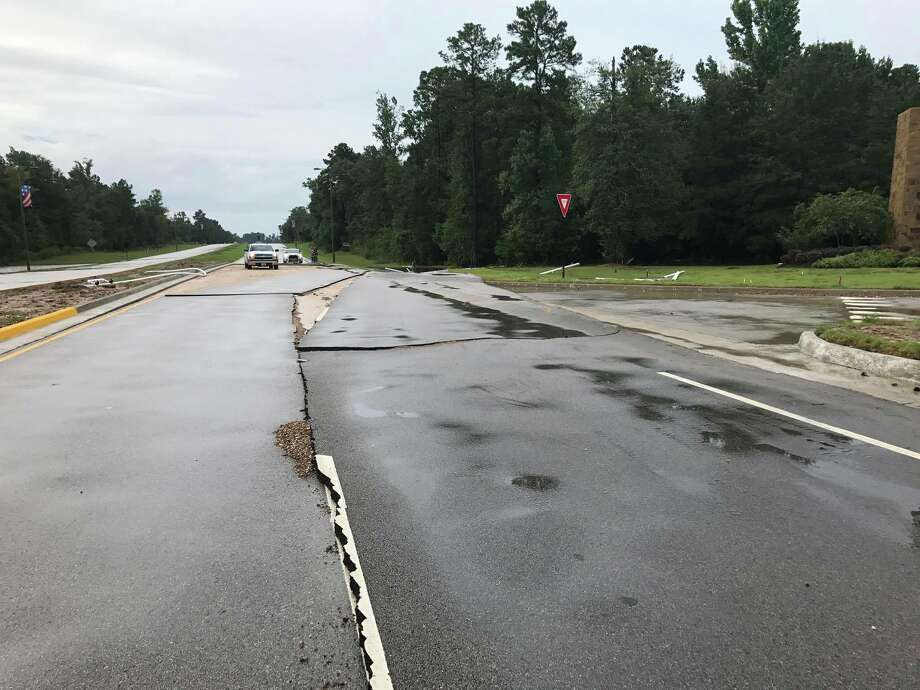 Tropical Storm Harvey flooding washed out a portion of the Fish Creek Thoroughfare at the entrance of Woodforest Subdivision. Officials closed Fish Creek Bridge and planned to divert all traffic to the northbound lane of the Fish Creek Thoroughfare Photo: Meagan Ellsworth