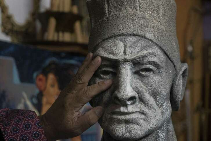 """Artist Gilbert Duran is restoring this sculpture of an American Indian, which he found in a thrift store. He believes it originally part of """"First Inhabitant,"""" the fountain by sculptor Waldine Tauch located on Commerce Street Bridge between Casa Rio and the Torch of Friendship."""