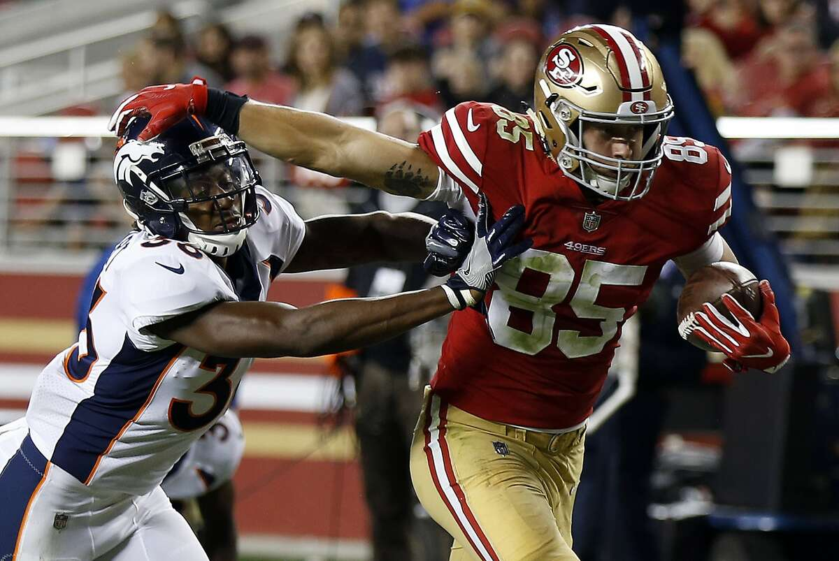 San Francisco 49ers tight end George Kittle (85) runs past Denver Broncos safety Orion Stewart on a touchdown reception during the second half of a preseason NFL football game Saturday, Aug. 19, 2017, in Santa Clara, Calif. (AP Photo/D. Ross Cameron)
