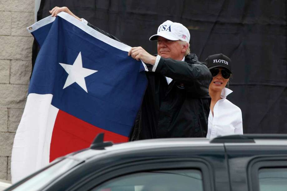"President Donald Trump, accompanied by his wife, Melania, drew wild cheers as he held up a Texas flag after saying ""Texas can handle anything"" to a crowd in Corpus Christi on Tuesday. Photo: Evan Vucci, STF / Copyright 2017 The Associated Press. All rights reserved."