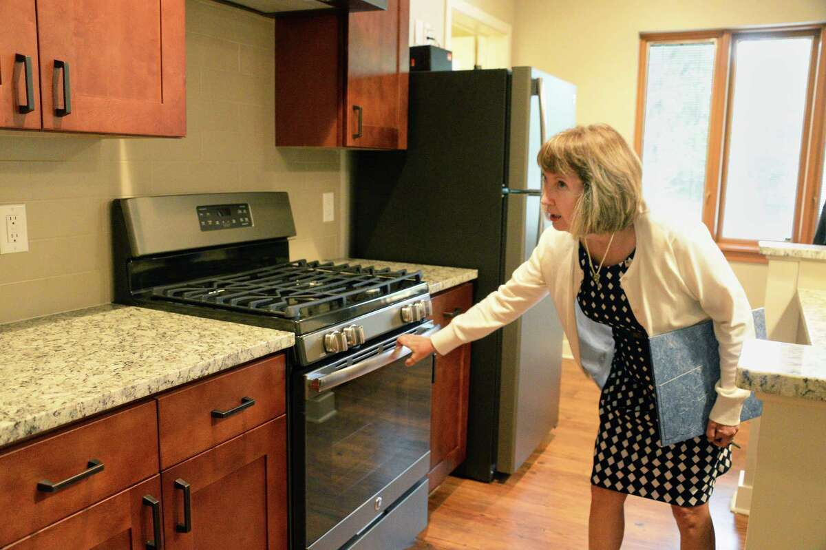 Rensselaer County Executive Kathy Jimino checks out alliances in the kitchen of an apartment during a tour of the new luxury Falls Edge Apartments on High Street Tuesday August 29, 2917 in Rennselaer, NY. (John Carl D'Annibale / Times Union)