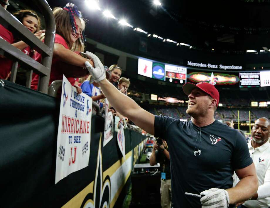 Long a fan favorite, three-time NFL Defensive Player of the Year J.J. Watt, right, has continually been forced to raise his fundraising goal upward as people respond to his call for help. Photo: Brett Coomer, Staff / © 2017 Houston Chronicle