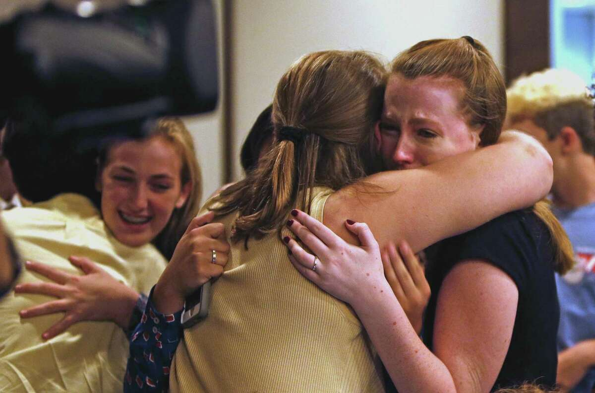 Peyton Spriester,17, R,is hugged by fellow student Kathryn Courtney,16, after board voted to change the name of Robert E.Lee HS. On Tuesday evening, the North East ISD board will vote on whether to change the name of Robert E. Lee High School in the wake of the events in Charlottesville and the national debate it started about Confederate monuments. at NEISD board room on Tuesday, August 29,2017