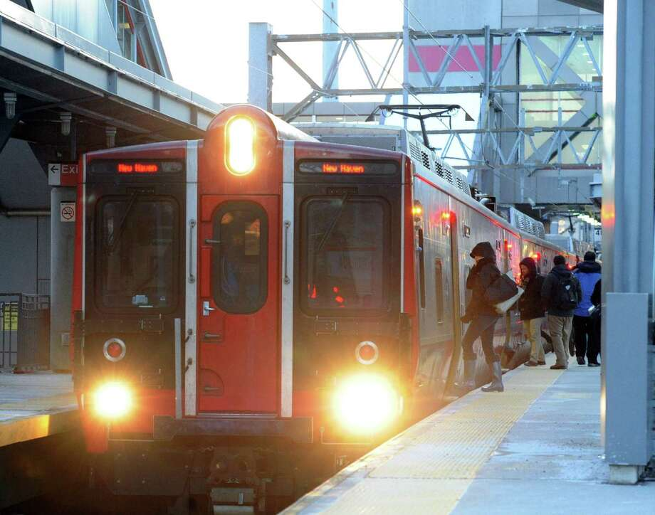 Passengers board a Metro-North train at the Stamford Train Station in February 2015. Photo: Hearst Connecticut Media File Photo / Greenwich Time