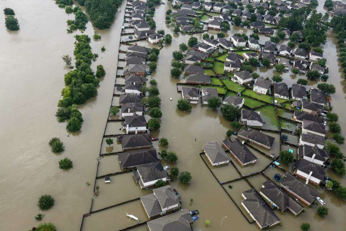 A neighborhood is inundated by floodwaters from Tropical Storm Harvey on Tuesday, Aug. 29, 2017, in Spring.
