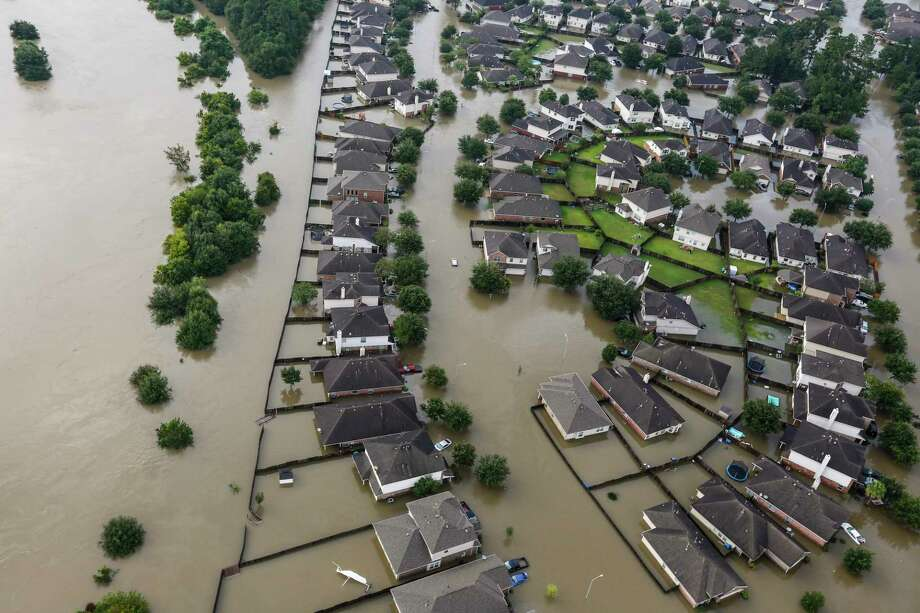 A neighborhood is inundated by floodwaters from Tropical Storm Harvey on Tuesday, Aug. 29, 2017, in Spring. Photo: Brett Coomer, Houston Chronicle / © 2017 Houston Chronicle