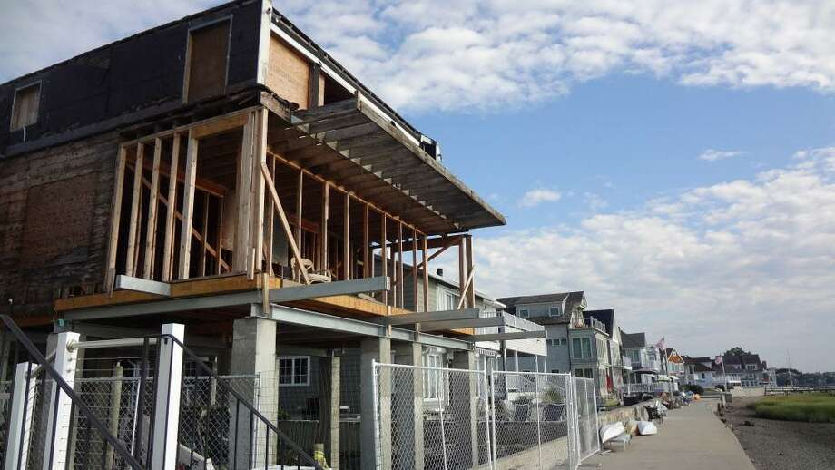 The framing of a home is elevated on stilts on Harbor View Avenue overlooking Norwalk harbor, as a new foundation is prepared below on August 19, 2016. Nearly four years after the Harbor View neighborhood was hit hard by Hurricane Sandy, many homes have been rebuilt to get above flood-stage waters, as well as in other parts of coastal Norwalk and Connecticut. Photo: Alexander Soule / Hearst Connecticut Media / Stamford Advocate