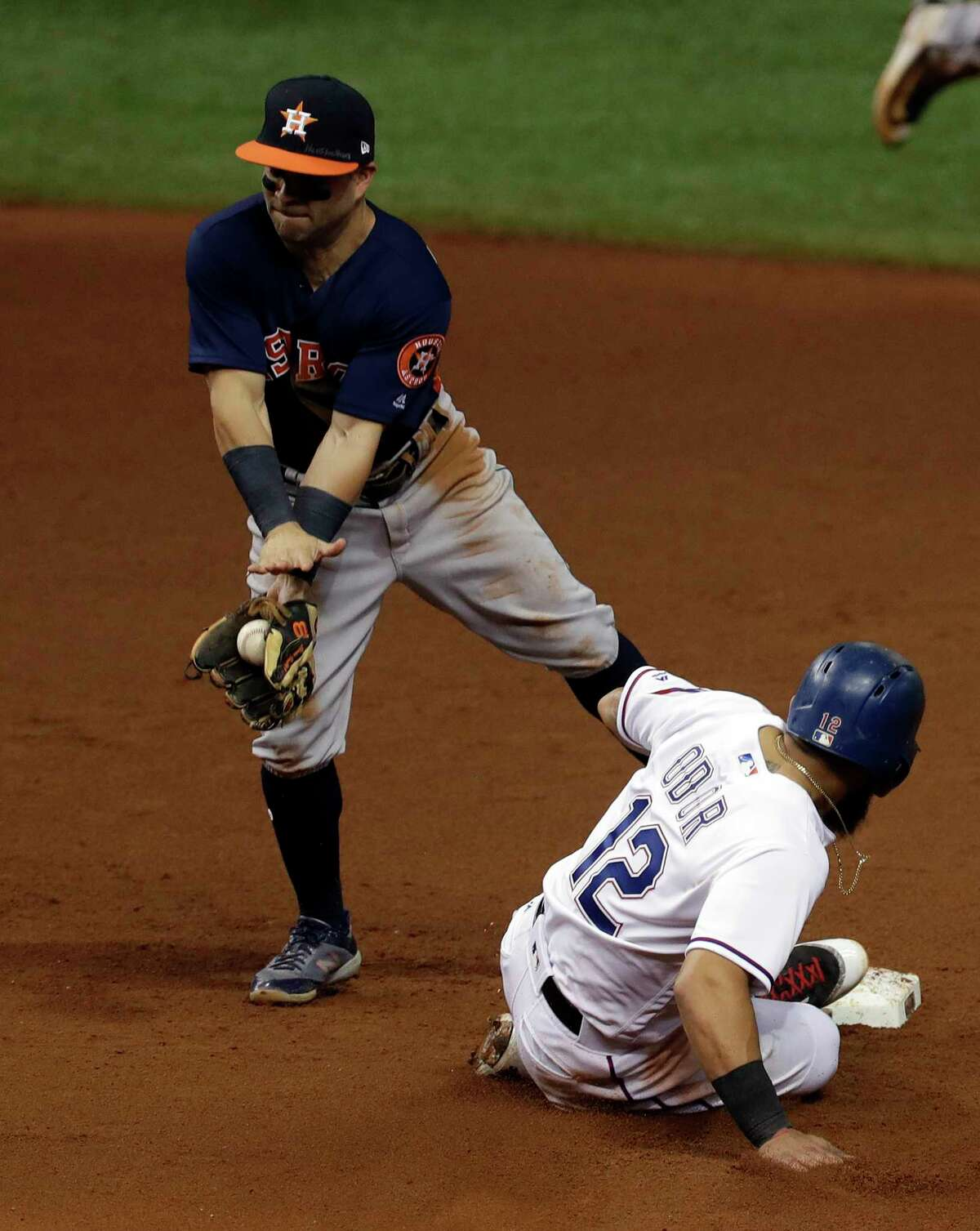 Texas Rangers' Rougned Odor steals second base in front of Houston Astros second baseman Jose Altuve during the fifth inning of a baseball game Tuesday, Aug. 29, 2017, in St. Petersburg, Fla. The Astros moved their three-game home series against the Rangers to St. Petersburg because of unsafe conditions from Hurricane Harvey. (AP Photo/Chris O'Meara)