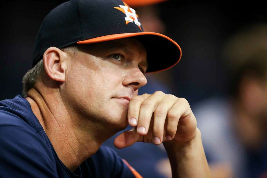 Houston Astros manager A.J. Hinch watches from the dugout in the first inning of the team's baseball game against the Texas Rangers in St. Petersburg, Fla., Tuesday, Aug. 29, 2017. (Will Vragovic/The Tampa Bay Times via AP) Photo: Will Vragovic, Associated Press / Tampa Bay Times