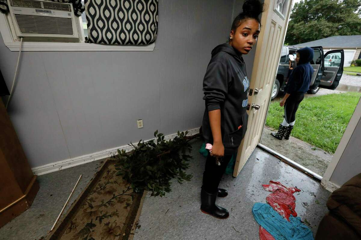 Hannah Goodly, 18, looks at her kitten as she prepares to leave her home in LakeCharles, La., on Tuesday. Goodly salvaged some clothes but was unable to take her kitten, Faith, with her to her temporary house.