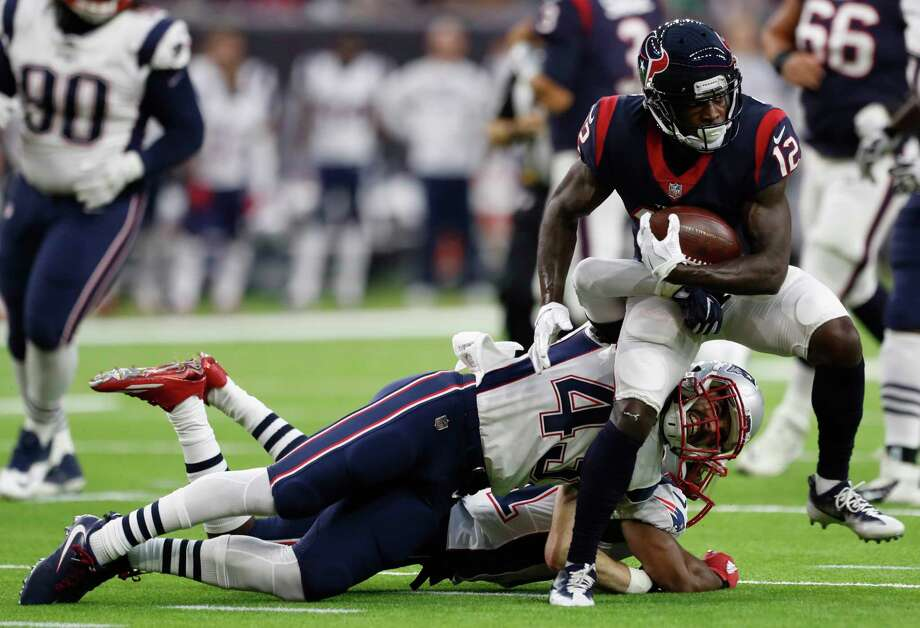 Texans receiver Bruce Ellington (12) breaks away from Patriots defensive back Nate Ebner (43) after making a reception during the teams' preseason game Aug. 19 at NRG Stadium. Photo: Karen Warren, Staff Photographer / @ 2017 Houston Chronicle