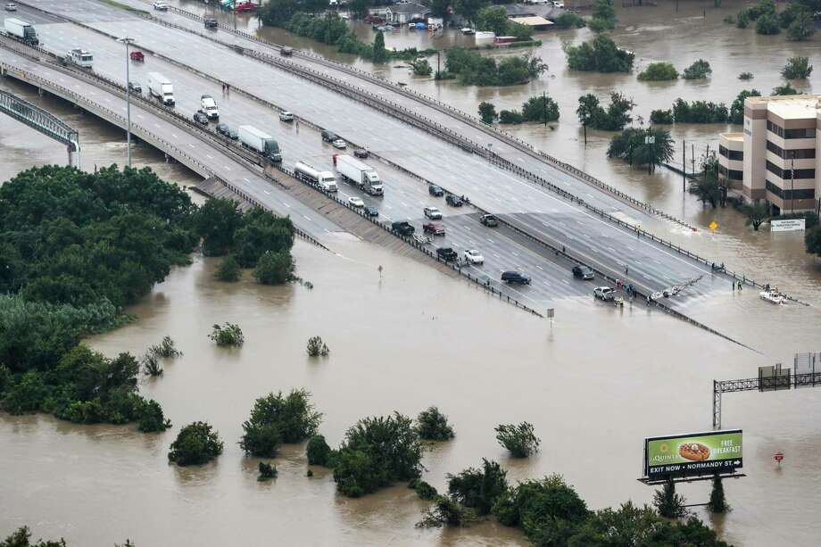 Interstate 10 at Market is shown blocked by floodwaters from Tropical Storm Harvey on Tuesday,