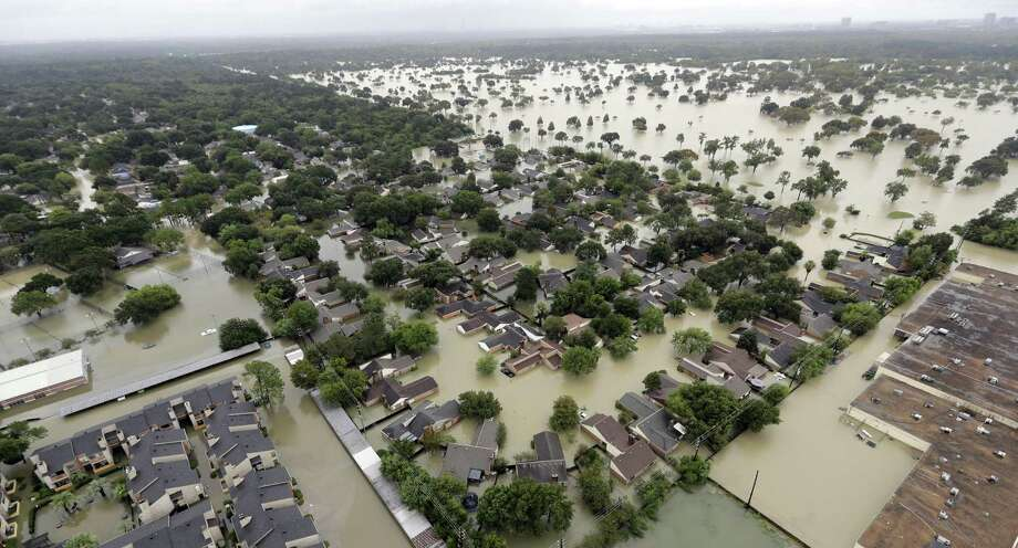 In this aerial photo, a neighborhood near Addicks Reservoir are flooded by rain from Tropical Storm Harvey Tuesday, Aug. 29, 2017, in Houston. (AP Photo/David J. Phillip) Photo: David J. Phillip, STF / Associated Press / Copyright 2017 The Associated Press. All rights reserved.