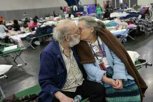 Don and Peg Sauter kiss as they take refuge from Tropical Storm Harvey at the George R. Brown Convention Center on Tuesday.  The couple celebrated their 55th wedding anniversary on Aug. 22. They were among 10,000 evacuees at the shelter.