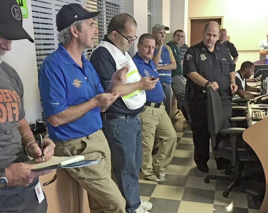"""Pasadena mayor Jeff Wagner (second from left) coordinates rescue and storm recovery efforts with a team of police and city officials at the emergency comma d center. Since Friday, Pasadena Police and a nearly-all volunteer fire department have responded to more than 1,000 calls for help and rescued more than 200 residents trapped by rising flood waters.""""Everyone on my team has put in an amazing amount of time and energy toward rescue and recovery efforts. But most importantly, we're blessed that we haven't had any fatalities in Pasadena due to flooding. We've focused on saving lives and helping people as much as possible,"""" Wagner said. Photo: City Of Pasadena"""