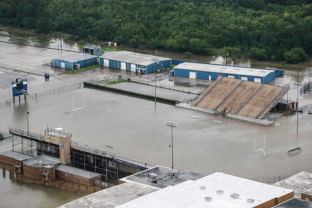 A football field at C.E. King High School is shown flooded by rising waters from Tropical Storm Harvey on Tuesday, Aug. 29, 2017, in Houston.