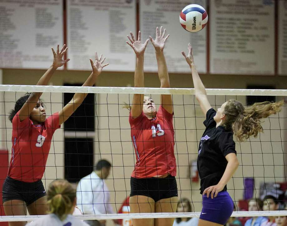 Antonian's Maylin Garrett (13) and Michaela Edwards (9) defend against Navarro's Allie Benner during a high school volleyball match, Tuesday, Aug. 29, 2017, at Antonian gym in San Antonio. (Darren Abate/For the Express-News) Photo: Darren Abate, FRE
