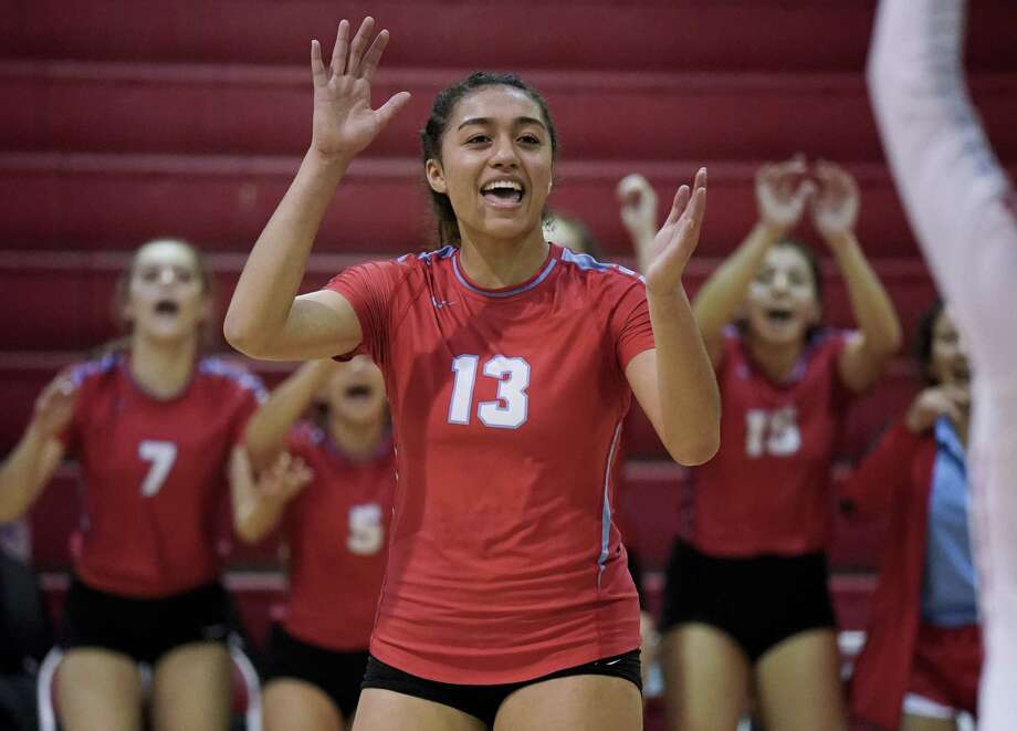 Antonian's Maylin Garrett celebrates a point during a high school volleyball match against Navarro, Tuesday, Aug. 29, 2017, at Antonian gym in San Antonio. (Darren Abate/For the Express-News) Photo: Darren Abate, FRE