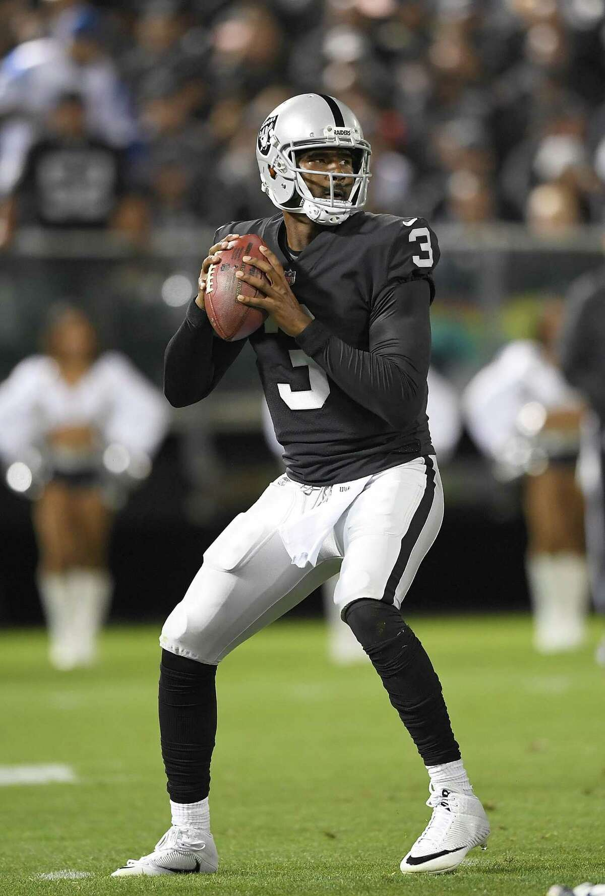 OAKLAND, CA - AUGUST 19: EJ Manuel #3 of the Oakland Raiders drops back to pass against the Los Angeles Rams during the third quarter of their preseason NFL football game at Oakland-Alameda County Coliseum on August 19, 2017 in Oakland, California. (Photo by Thearon W. Henderson/Getty Images)