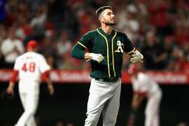 ANAHEIM, CA - AUGUST 29:  Matt Joyce #23 of the Oakland Athletics looks on after flying out to end the third inning during a game against the Los Angeles Angels at Angel Stadium of Anaheim on August 29, 2017 in Anaheim, California.  (Photo by Sean M. Haffey/Getty Images)