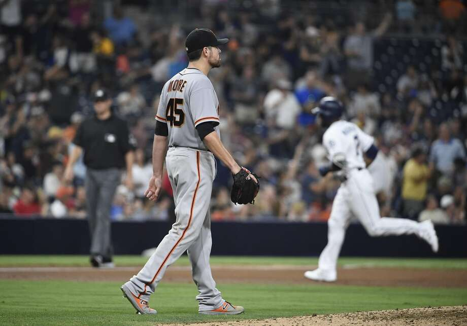 Matt Moore walks back to the mound after giving up a second home run in the fourth, a three-run home run by Manuel Margot. Photo: Denis Poroy, Getty Images