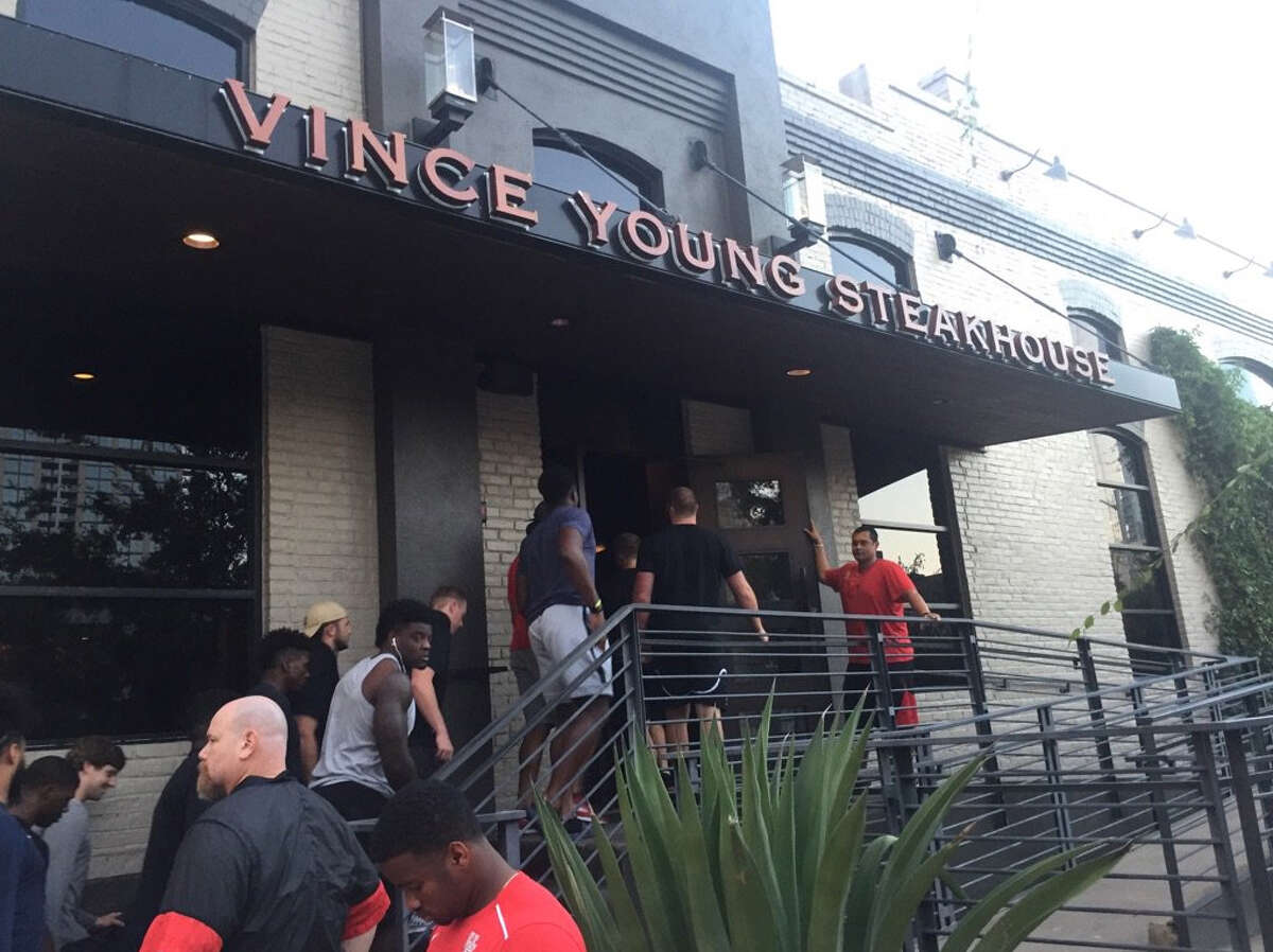 Vince Young hosted the University of Houston football team at his steakhouse in Austin on Tuesday.